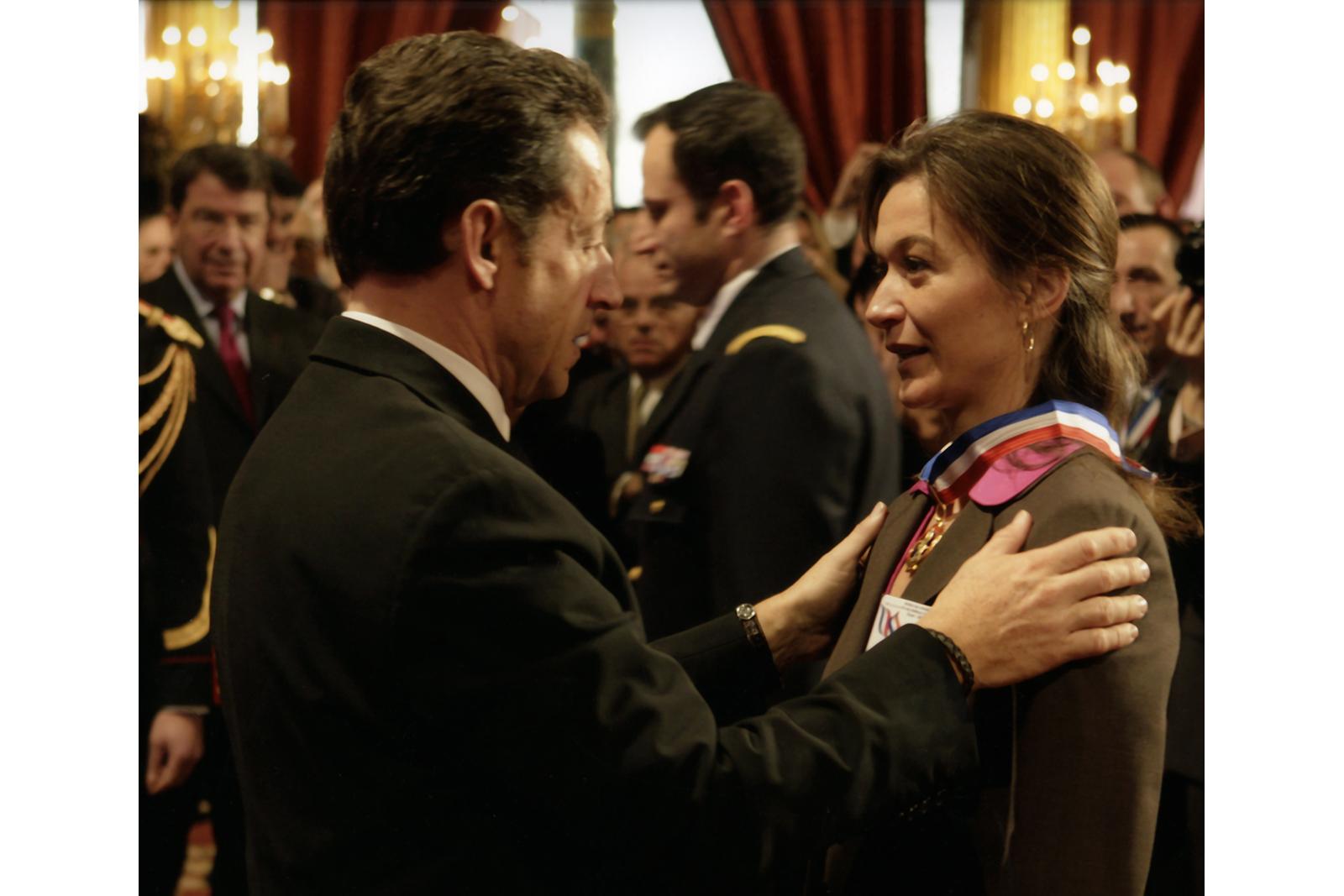 Sandrine and French president Nicolas Sarkozy