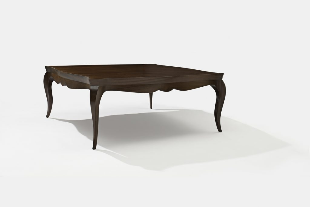 coffee table in mahogany with sculpted legs