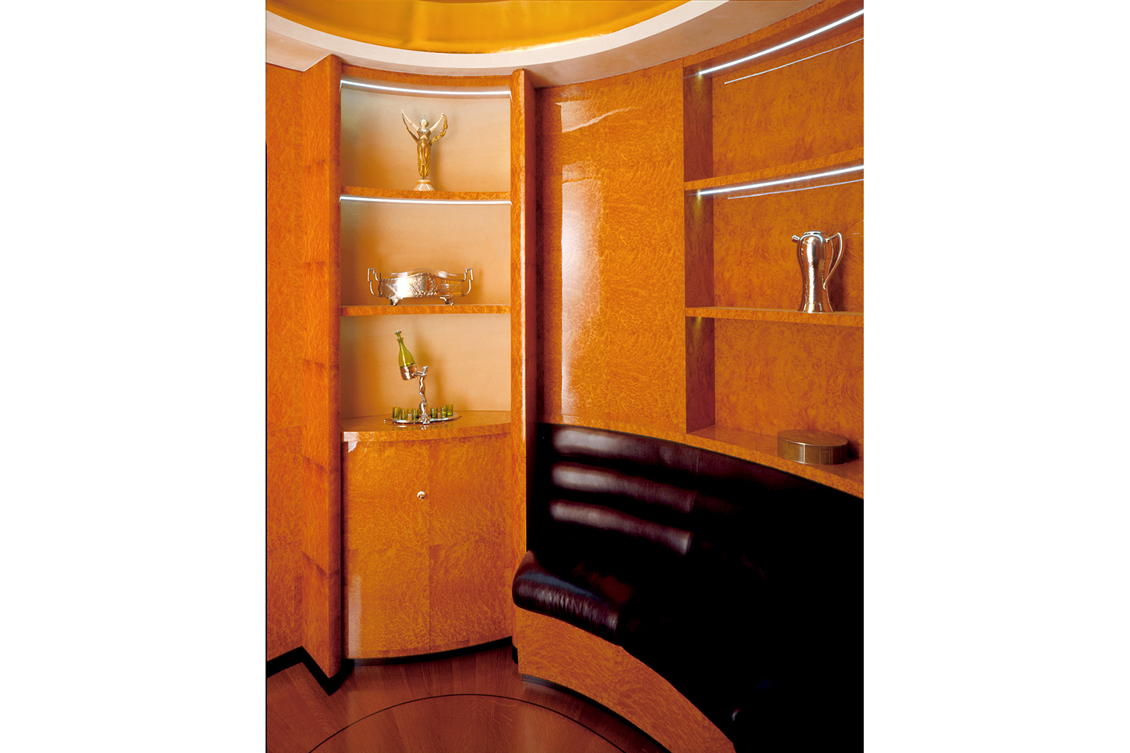 Private Lounge In Myrtle Burl And Leather